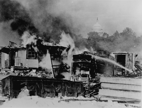 """Shacks, put up by the Bonus Army on the Anacostia flats, Washington, D.C., burning after the battle with the military. The Capitol in the background. 1932."" (ARC Identifier: 531102); Signal Corps Photographs of American Military Activity, 1754 - 1954; Records of the Office of the Chief Signal Officer, 1860 - 1982; Record Group 111; National Archives."